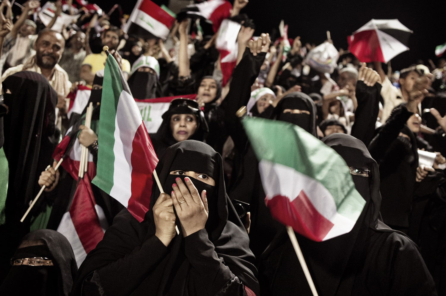 Fans attend a Gulf Cup soccer match between Iraq and Kuwait in Sanaa.