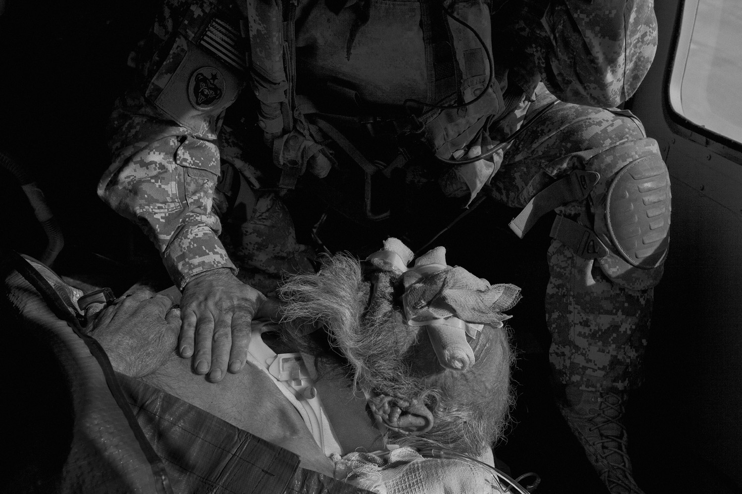 The crew members treat an Afghan man who was injured when his truck rolled over into an irrigation ditch. In addition to responding to wounded American and coalition troops, the medevac units provide care for ordinary Afghans with grave medical conditions.