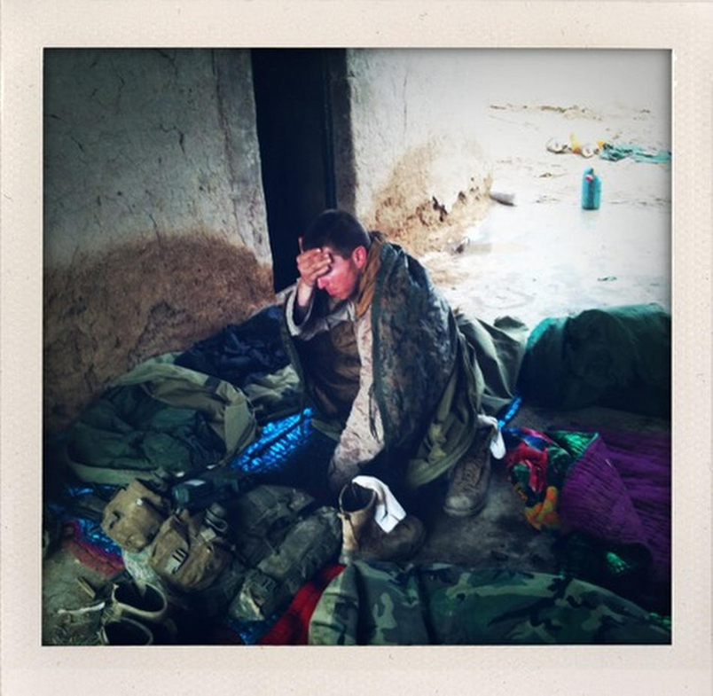 A U.S. Marine wakes up in the morning after sleeping with his platoon in a mud walled compound in Marjah in Afghanistan's Helmand province. (AP Photo/David Guttenfelder)