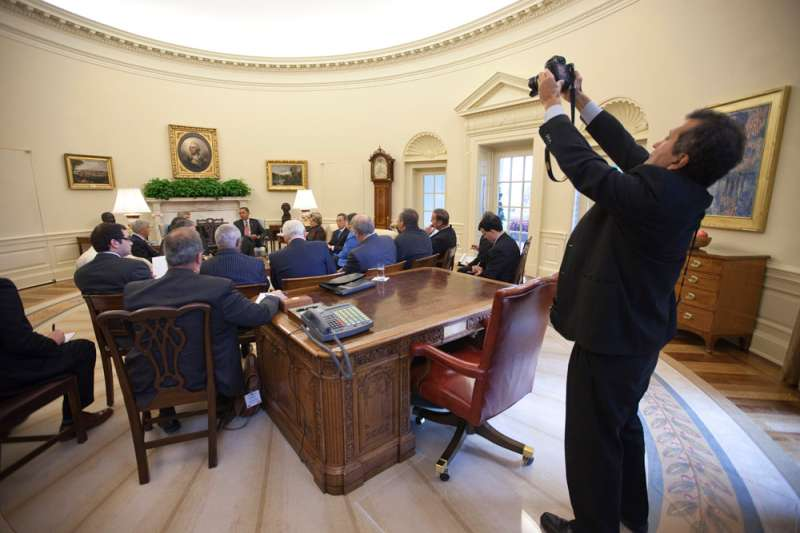 White House Photographer Pete Souza photographs President Obama as he meets with a delegation from Canada
