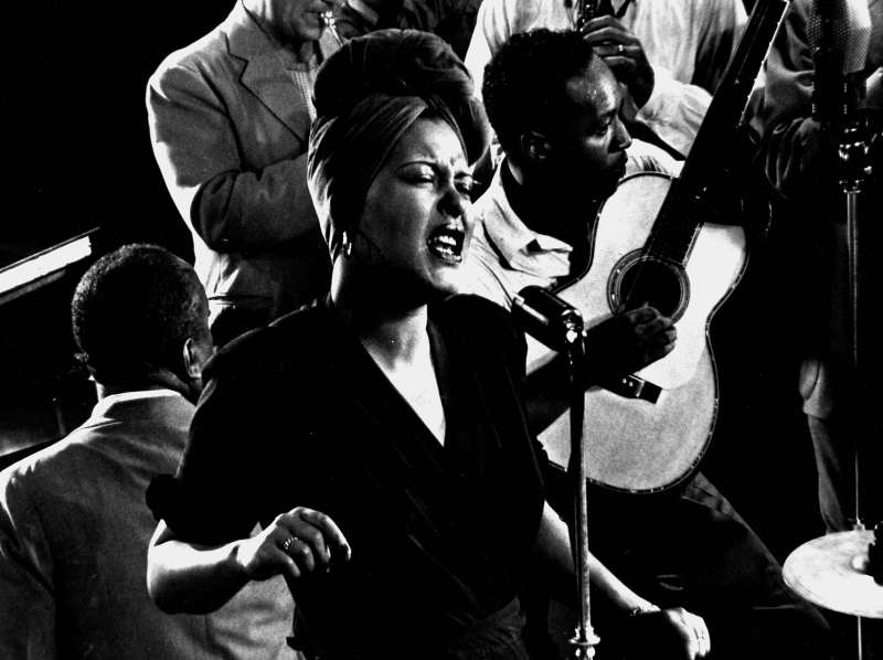 Billie Holiday (here at LIFE photographer Gjon Mili's New York studio in 1942) had a hard-knock life, and it showed in her singing, which was intimate, soul-searching, and unforgettable.
