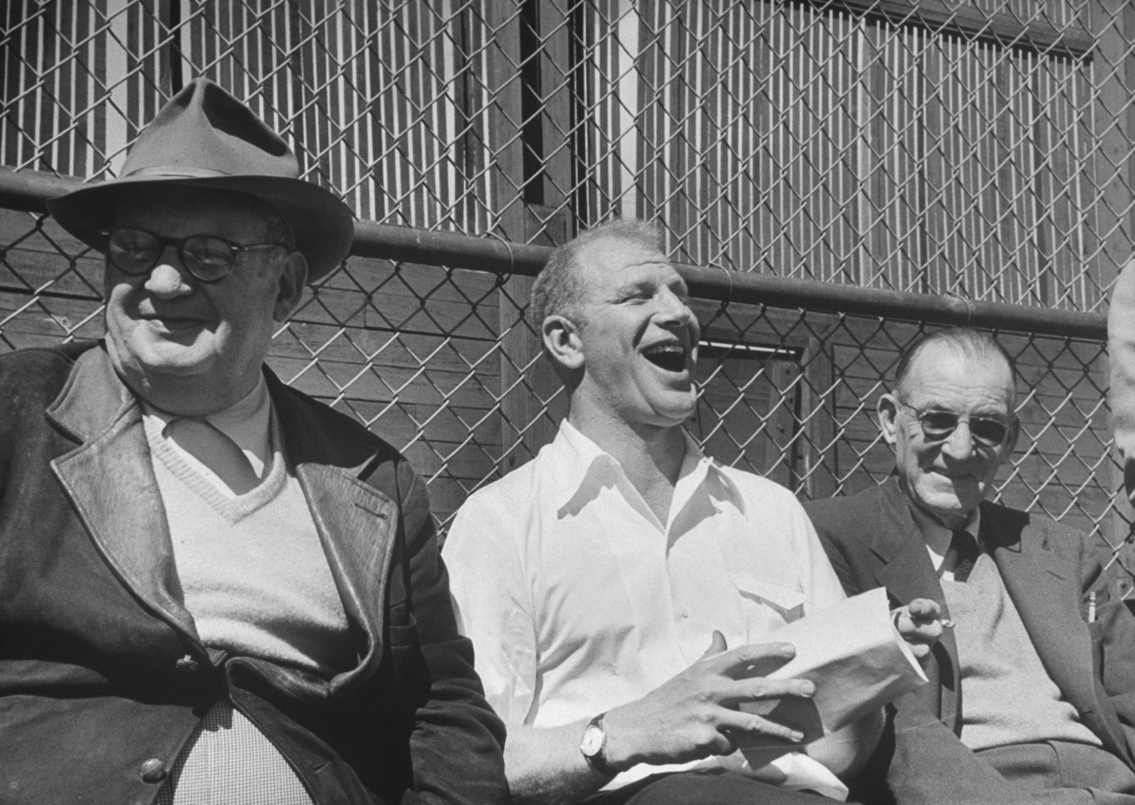 Bill Veeck (center) erupts in laughter reading a sports column picking his St. Louis Browns to finish in first place in the American League in 1952. Few people ever had more fun around baseball -- or brought more enjoyment to more baseball fans -- than the Chicago native. Owner, at various times, of the Indians, the Browns, and the Chicago White Sox, Veeck (rhymes with  wreck ) is remembered and still celebrated as a man who refused to take the game he loved -- or himself -- too seriously. Oh, and that 1952 season? The Browns finished seventh, 31 games out of first.