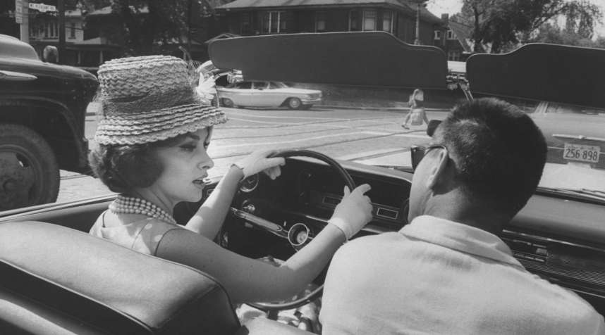 Gina Lollobrigida, then 33, takes a driving lesson through the streets of Toronto, Canada in July 1960.