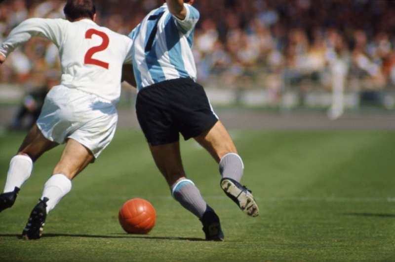 Not published in LIFE. England's George Cohen vies with Argentina's Silvio Marzolini during a World Cup quarterfinal match, 1966.