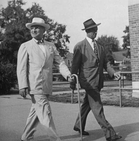 President Harry S Truman (left) is matched stride for stride with his Secret Service agent, John Campion.
