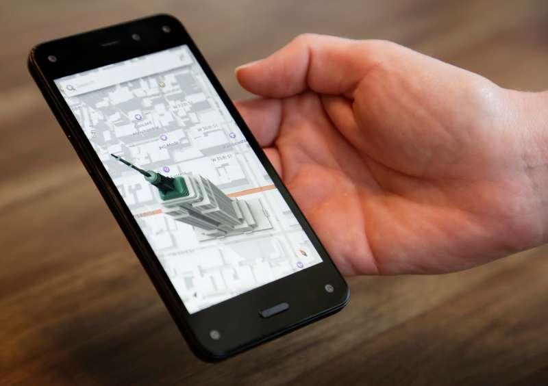 An Amazon representative shows off the 3D map features of the company's new Fire smartphone at the company's campus in Seattle, Washington June 18, 2014.