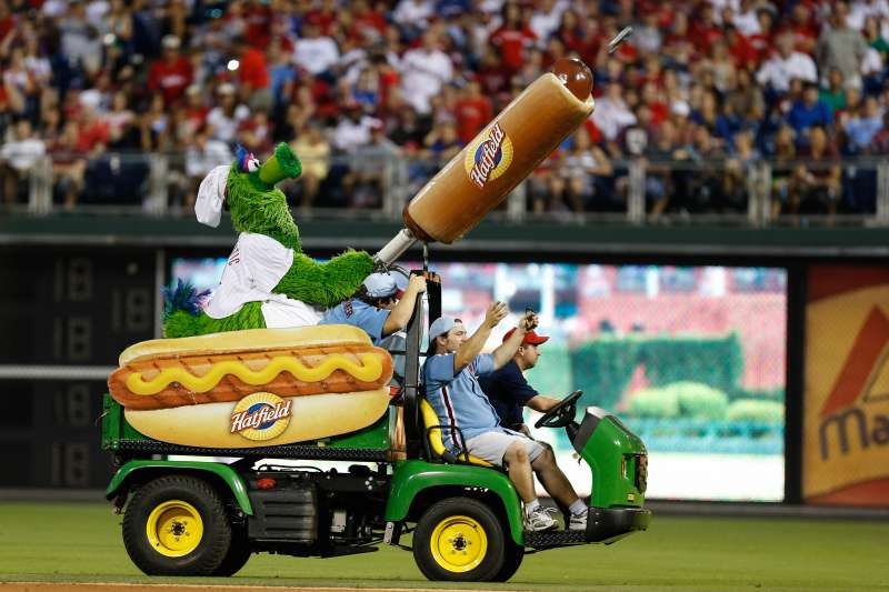 The Philadelphia Phillies mascot the Phillie Phanatic shoots a Hatfield Hot Dog into the stands at Citizens Bank Park.