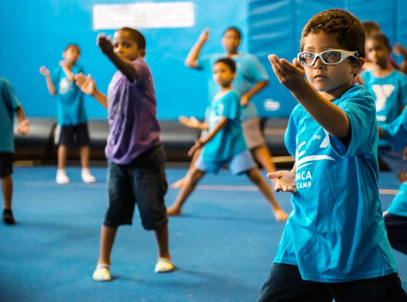 Karate chop your child care costs with a YMCA  camp such as this one in Jamaica, N.Y.—where participants practice martial arts among other things.