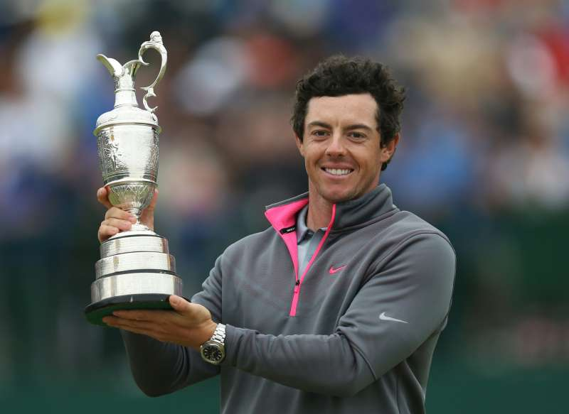 Rory McIlroy of Northern Ireland holds up the Claret Jug trophy after winning the British Open Golf championship at the Royal Liverpool golf club, Hoylake, England, Sunday July 20, 2014.