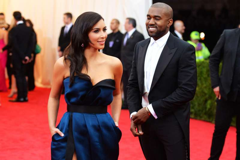 Kim Kardashian (L) and Kanye West attend the  Charles James: Beyond Fashion  Costume Institute Gala at the Metropolitan Museum of Art on May 5, 2014 in New York City.