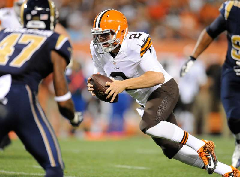 Johnny Manziel of the Cleveland Browns scrambles for a touchdown during the third quarter against the St. Louis Rams at FirstEnergy Stadium on August 23, 2014, in Cleveland, Ohio.