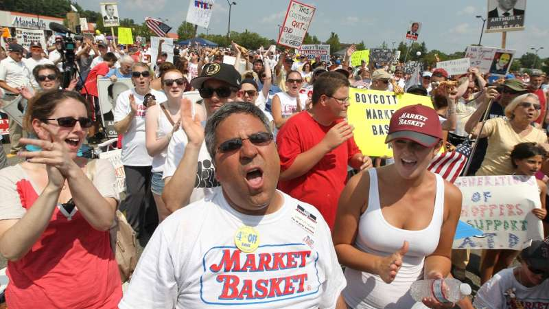 TEWKSBURY, MA - AUGUST 5: From left front, employees Ann Arsenault (grocery clerk), Larry Frost (head cashier) and Leighann Hodgkins (customer service), all from Billerica #17, cheer near the end of the rally. Market Basket employees, customers and supporters rally in Tewksbury, on Tuesday, August 5, 2014. (Photo by Pat Greenhouse/The Boston Globe via Getty Images)