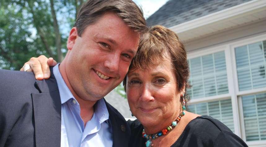 Purple Heart Homes co-founder John Gallina with Vicki Thomas