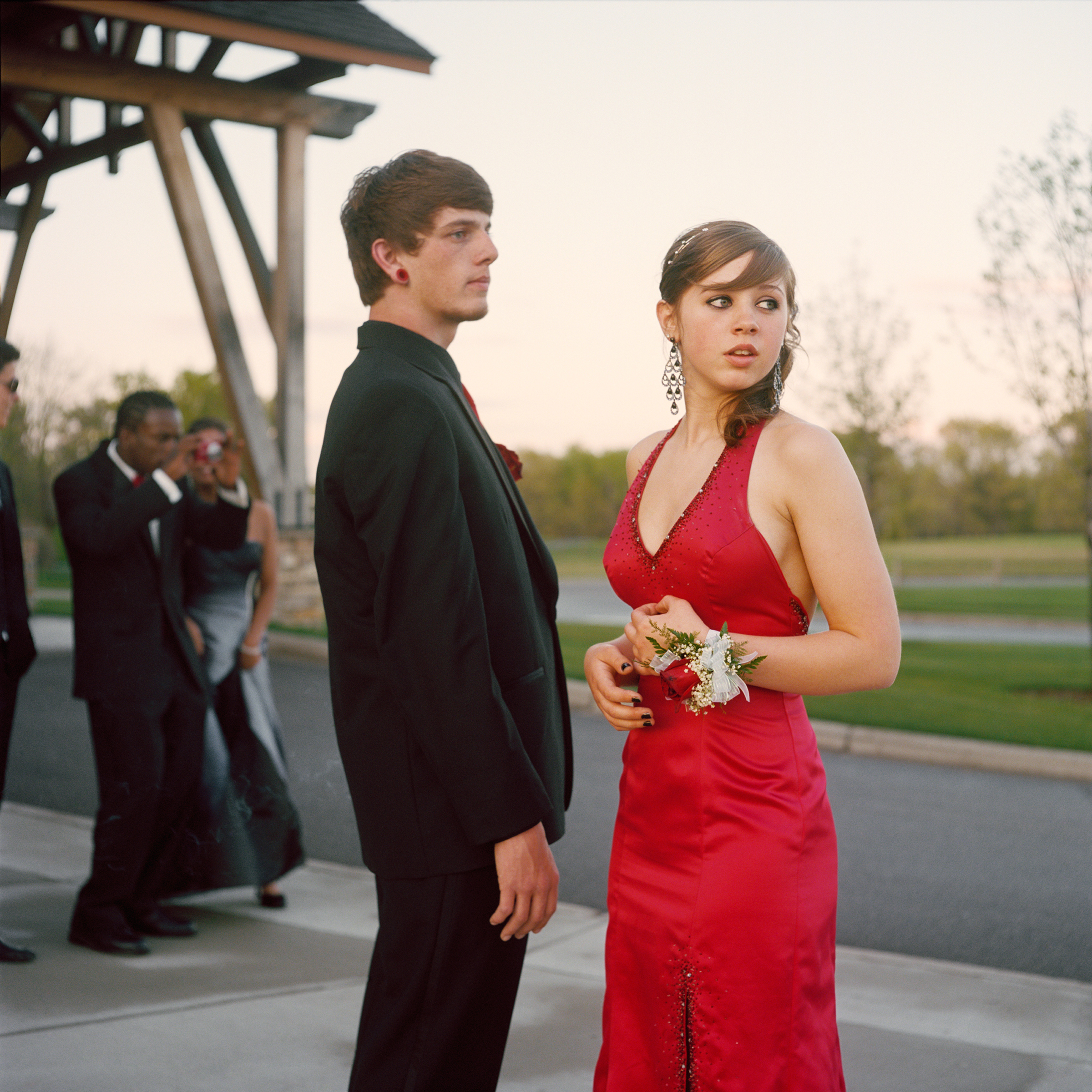 """<strong>In 2014, the average cost for a prom dress was $195, according to <a href=""""http://www.statisticbrain.com/prom-night-statistics/"""" title=""""Statistic Brain"""" target=""""_blank"""">Seventeen Magazine</a>. On top of this, a teen girl's prom expenses include shoes, handbag, hair, makeup, manicure and jewelry.  However, teen boys are often expected to bear the costs for many prom activities, and the average costs of a limousine for four hours can be $450 and prom tickets can be $75.  This excludes his tuxedo, accessories, their dinner and transportation. For help making a budget, get the <a href=""""http://www.practicalmoneyskills.com/resources/prom2014.php"""" title=""""Visa Plan'it Prom app"""" target=""""_blank"""">Visa Plan'it Prom app</a>.</strong>                                                                              Title: """"Nick and Angel,"""" from the series <em><a href=""""http://amyandersonart.com/crossroads.htm"""" title=""""At Risk, With Promise"""" target=""""_blank"""">At Risk, With Promise.</a></em>                                                                              <a href=""""http://amyandersonart.com/"""" title=""""Amy Anderson"""" target=""""_blank"""">Amy Anderson</a> has been documenting students at Crossroads Alternative High School for the last four years. Coming from diverse backgrounds, they have been unable to be successful in a traditional school setting for various reasons. Some are brilliant, kind, articulate teenagers; some are abused, addicted, angry youth…many are both. Though they carry the wounds and fears of their past, her portraits honor the strength that develops as they begin a new journey and make changes and choices that will shape their lives."""