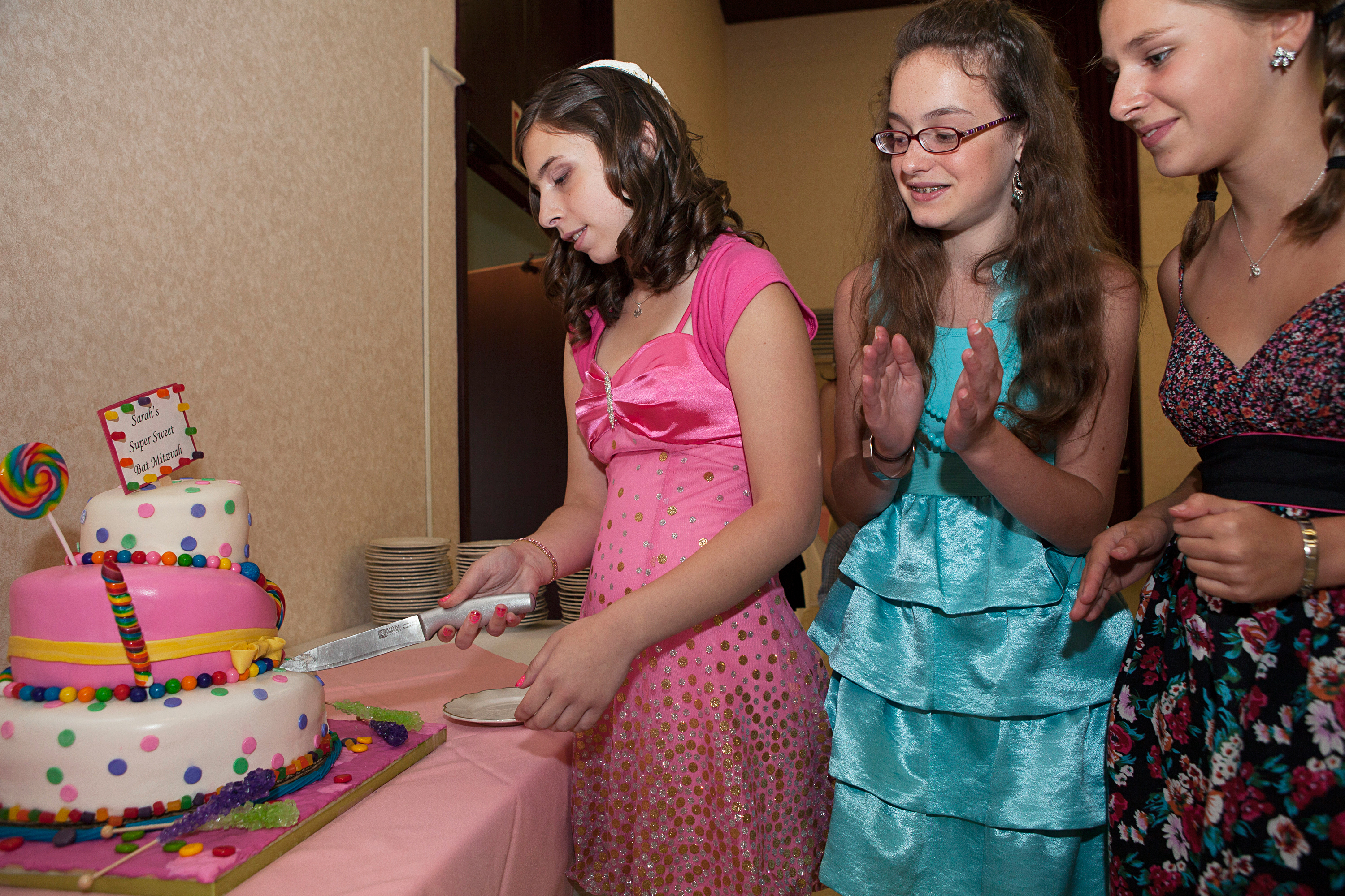 """<strong>According to industry estimates, """"the average bar or bat mitzvah budget runs roughly $15,000 to $30,000,"""" writes <a href=""""http://www.emitz.com/budget"""" title=""""eMitz.com: the Bar Bat Mitzvah Planning, Ideas, Vendor Reviews and Invitations Site"""" target=""""_blank"""">eMitz.com</a>, the Bar and Bat Mitzvah Planning site. """"Many variables come into play, such as: time of year, time of day, number of guests and the region.  Manhattan and LA are the priciest.""""</strong>                                                                              Title: """"Sarah's Bat Mitzvah, Buffalo, NY,"""" from the series <a href=""""http://www.rebeccagreenfield.com/#a=0&amp;at=0&amp;mi=2&amp;pt=1&amp;pi=10000&amp;s=0&amp;p=4"""" title=""""Coming of Age"""" target=""""_blank""""><em>Coming of Age.</em></a>                                                                              <a href=""""http://www.rebeccagreenfield.com/"""" title=""""Rebecca Greenfield"""" target=""""_blank"""">Rebecca Greenfield</a> has been documenting contemporary American female rites of passage for the past six years, photographing coming of age traditions such as Quinceañeras, Bat Mitzvahs, Debutante Balls, Prom, Homecoming, Sweet Sixteen, Purity Balls, Sorority Rush, Apache Sunrise Dances and more. She looks forward to publishing the project in book form when complete."""