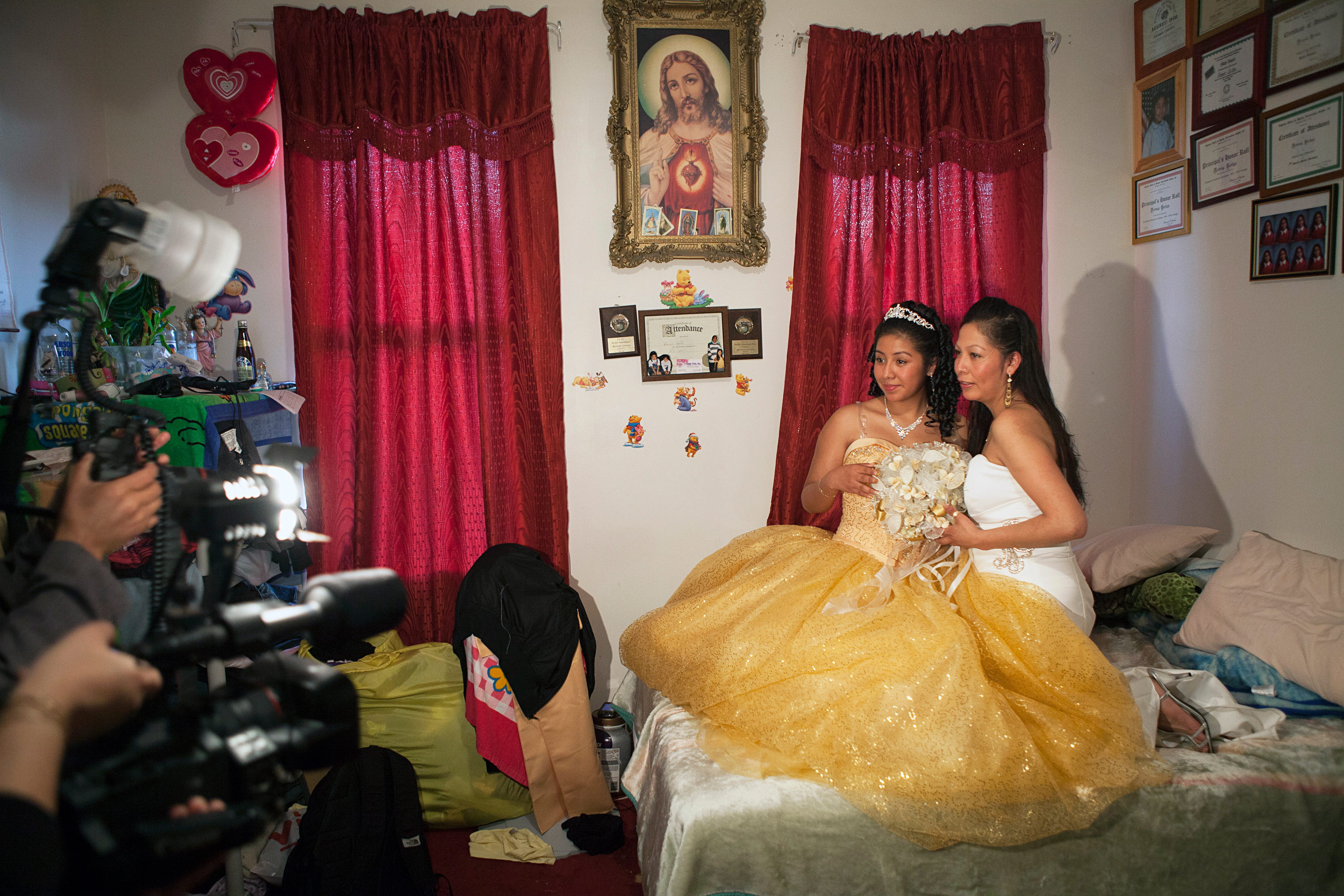 """<strong>More than 400,000 Hispanic girls celebrated quinceañeras in 2011. Each family spent an average of $5,000 to $10,000, adding up to a $2 million- to $4 million-dollar industry, states <a href=""""http://corporate.univision.com/2011/09/latina-moms-and-the-quinceanera-tradition/"""" title=""""Univision – Latina Moms and the Quinceañera Tradition"""" target=""""_blank"""">Univision Communications.</a></strong>                                                                              Title: """"Ronnie and her mom pose for a photographer and videographer they've hired to document Ronnie's Quinceañera, Brooklyn, NY,"""" from the series <em><a href=""""http://www.rebeccagreenfield.com/#a=0&amp;at=0&amp;mi=2&amp;pt=1&amp;pi=10000&amp;s=0&amp;p=5"""" title=""""Coming of Age"""" target=""""_blank"""">Coming of Age.</a></em>"""