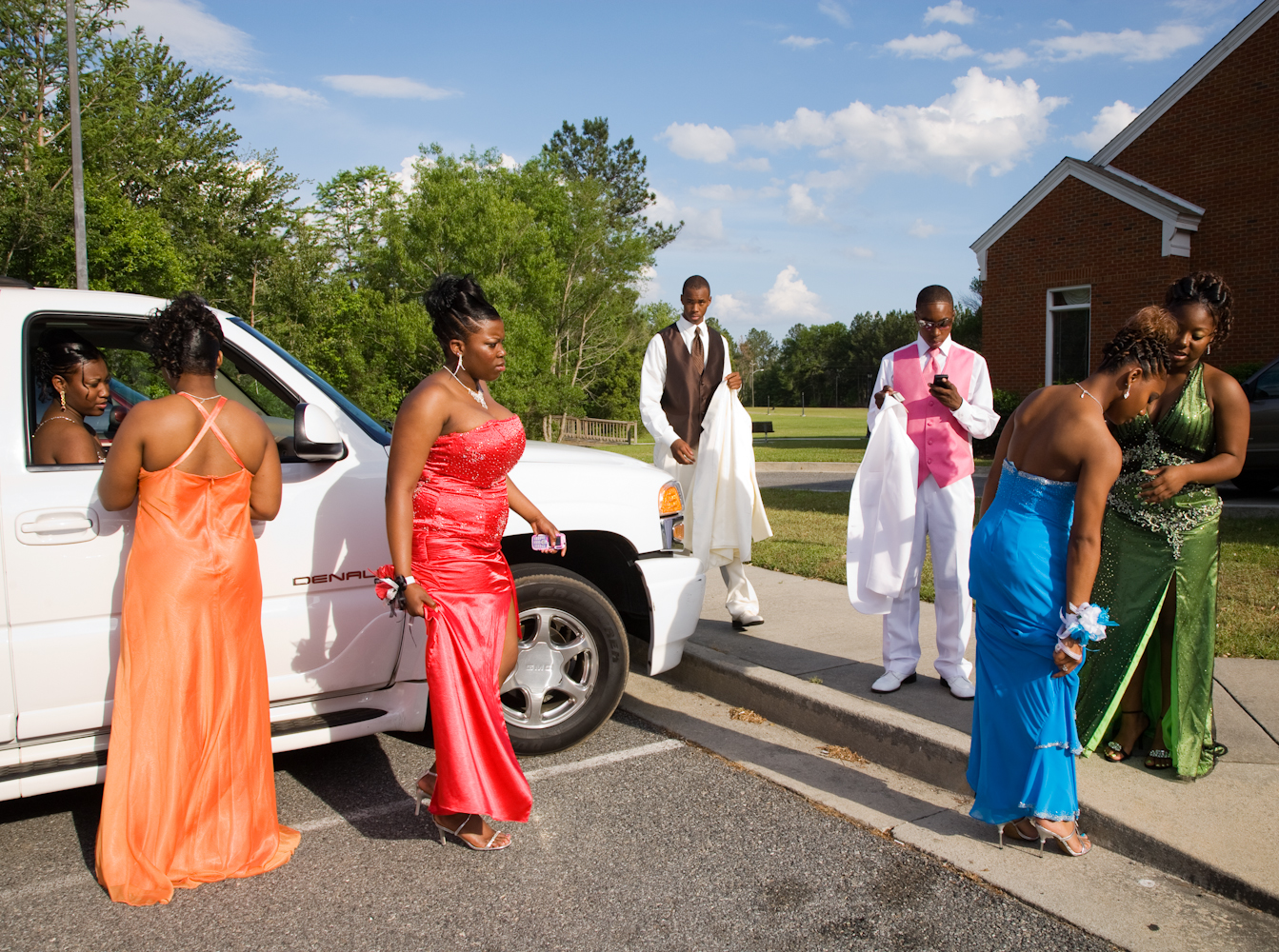 """<strong>On average, in 2014, Southern families spent nearly $200 less on prom-related costs than the Northeast and West Coasts, the <a href=""""http://www.practicalmoneyskills.com/resources/pdfs/Visa_Prom_Survey_2014.pdf"""" title=""""2014 Visa Prom Spending Survey"""" target=""""_blank"""">2014 Visa Prom Spending Survey</a> discovered. The American average household spending on the annual high school rite of passage was $978.  Parents were planning to pay for 56% of prom costs, while their teens covered the remaining 44%.  </strong>                                                                              Title: """"Parking Lot of the First Integrated Prom, Lyons, Georgia 2010,"""" from the series <a href=""""http://www.gillianlaub.com/#/Works%20and%20Projects/Southern%20Rites/1/"""" title=""""Southern Rites"""" target=""""_blank"""">Southern Rites.</a>                                                                              For more than five years, <a href=""""http://www.gillianlaub.com/"""" title=""""Gillian Laub"""" target=""""_blank"""">Gillian Laub</a> has photographed Mt. Vernon, a town in Georgia where—despite the integration of its schools in 1971—the high school's fall homecoming and spring prom remain racially segregated. In 2009, <a href=""""http://www.nytimes.com/interactive/2009/05/24/magazine/dividedproms-audioss/"""" title=""""New York Times Magazine – A Prom Divided"""" target=""""_blank"""">The New York Times Magazine published some of these images in a photo essay and multimedia piece, """"A Prom Divided.""""</a> It caused national outrage. Now, there is only one homecoming queen and one prom."""