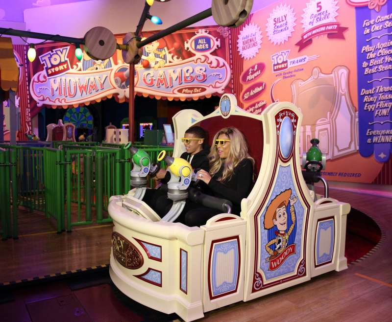 Daytime TV talk show host Wendy Williams and her son Kevin take a ride on  Toy Story Midway Mania!  during a visit to Disney's Hollywood Studios theme park at Walt Disney World Resort January 19, 2014 in Lake Buena Vista, Florida.