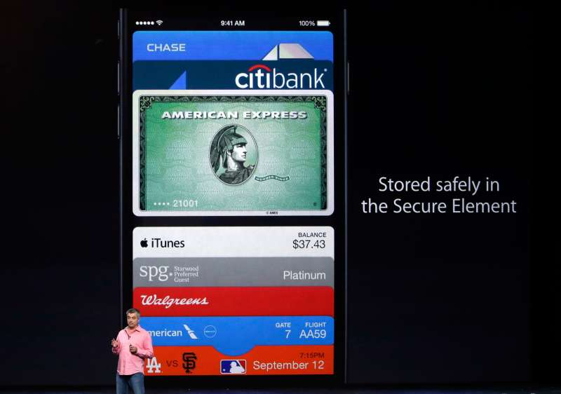 Apple executive Eddy Cue shows off the new Apple Pay system.