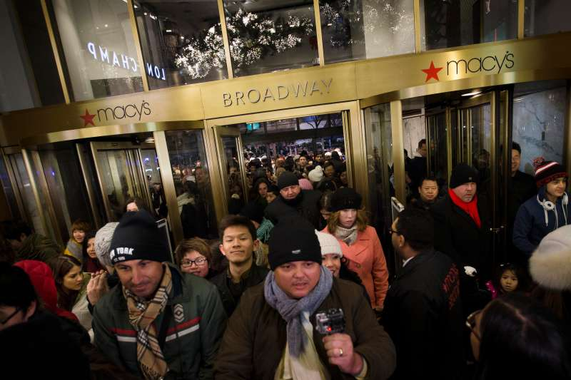 Eager shoppers crowd the entrance as they pour into the Macy's Herald Square flagship store, Thursday, Nov. 28, 2013, in New York.