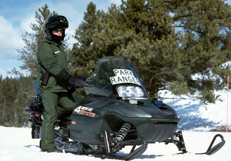 Ranger with snowmobile, Yellowstone National Park, Wyoming.