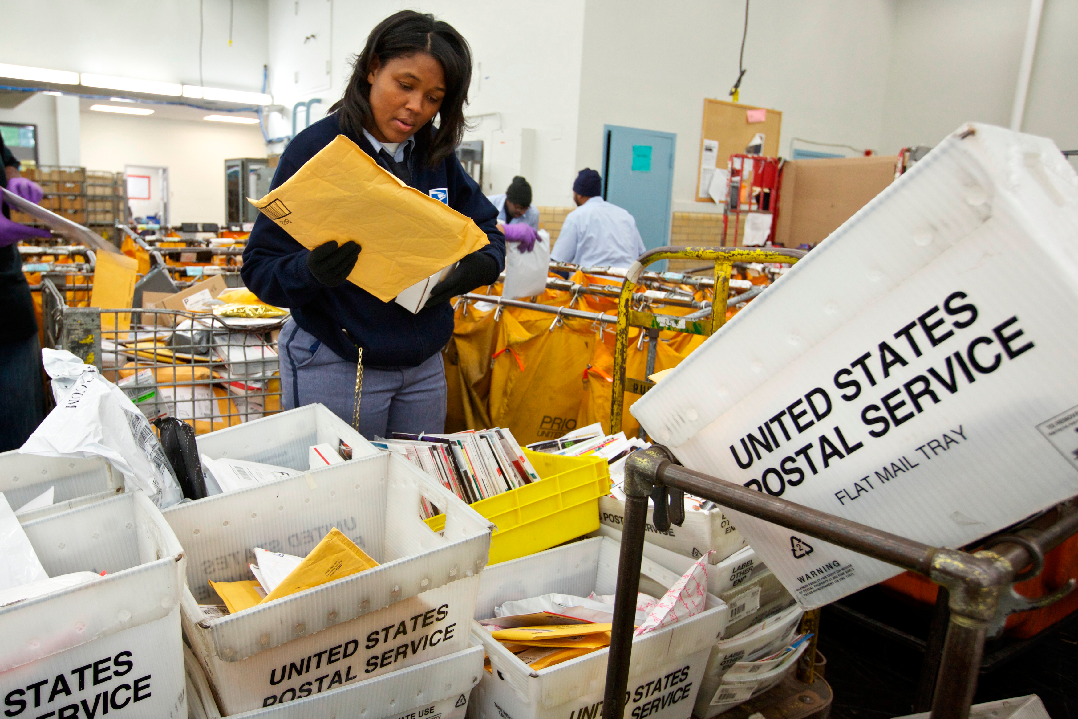 USPS worker sorting packages