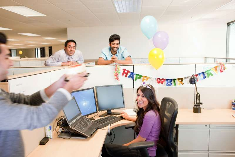 Colleagues celebrating birthday in office