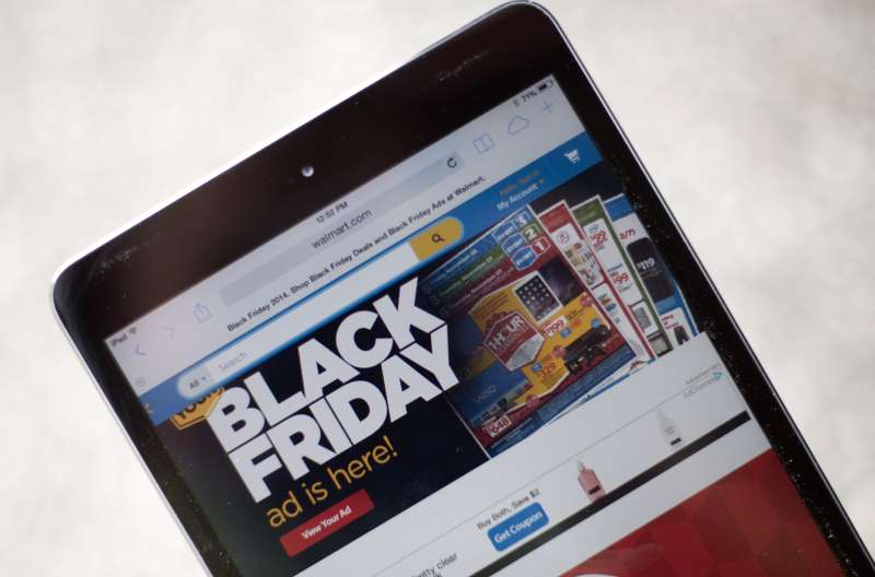 A  Black Friday  advertisement for Walmart is seen on an iPad in Annapolis, Maryland November 16, 2014.  Black Friday  is coming early this year to retailers.