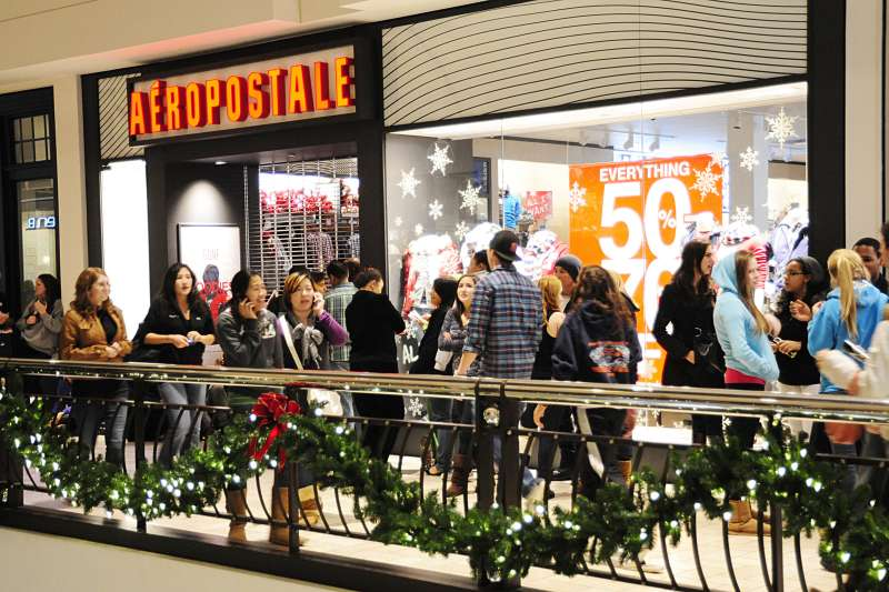 Shoppers wait to enter the Aeropostale store in Tyson's Corner, Virginia during 'Midnight Madness' at the Tyson's Corner Center in Tyson's Corner, Virginia.. Tyson's Corner Center is the largest shopping center in the Washington, DC area.