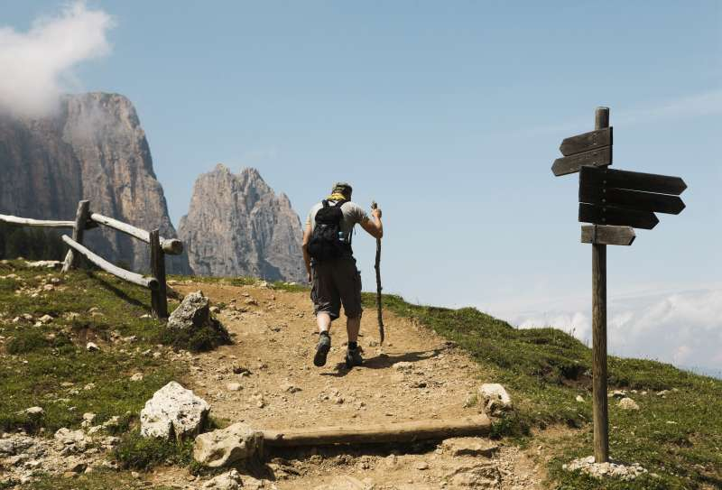 Backpacker on mountain trail