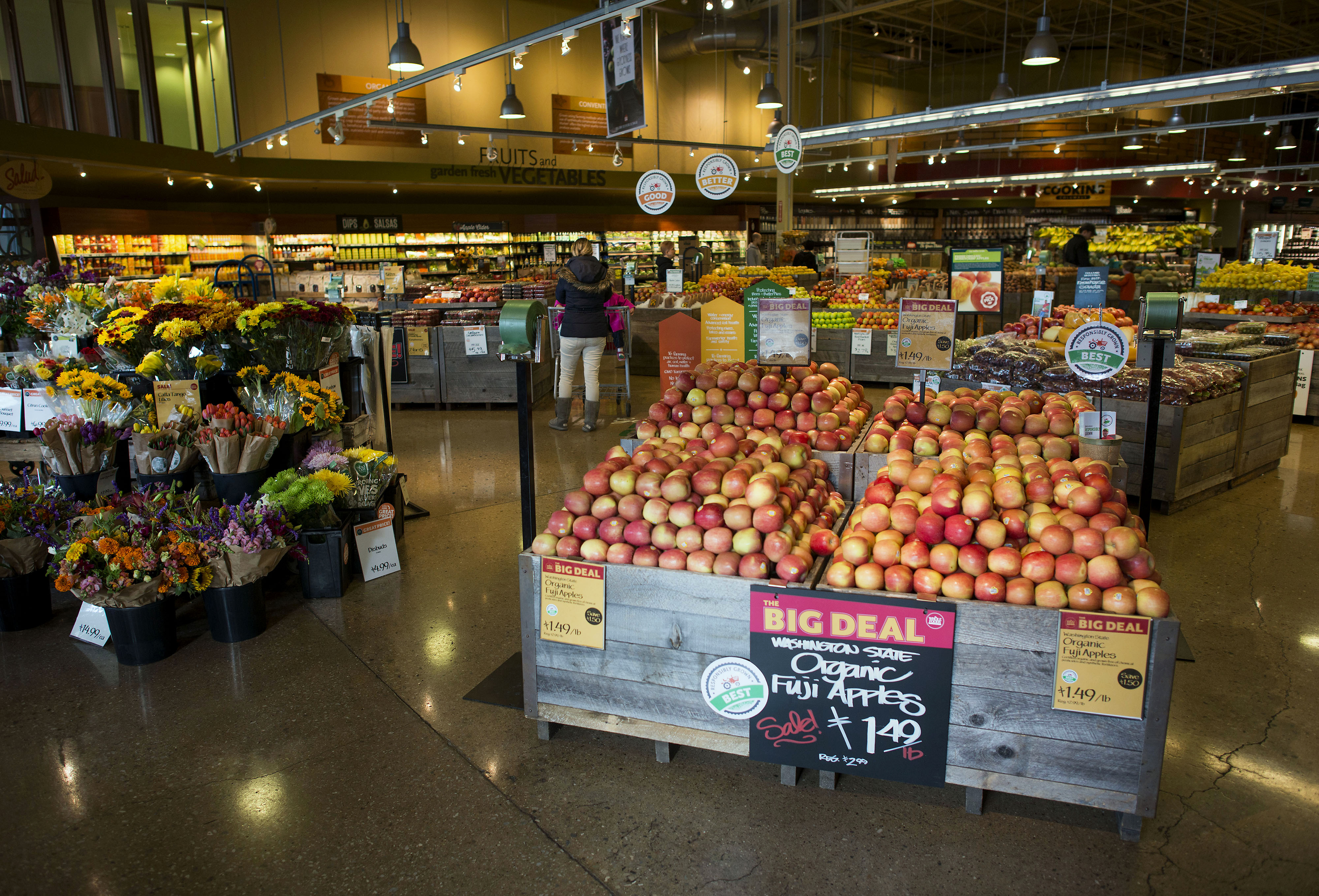 Customers shop in the produce section of a Whole Foods Market Inc. store in Dublin, Ohio, U.S., on Friday, Nov. 7, 2014.