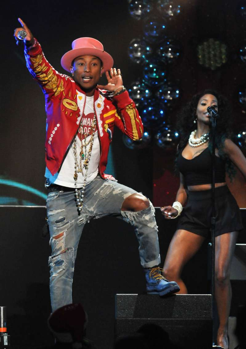 Pharrell Williams performs onstage during 93.3 FLZ's Jingle Ball 2014 at Amalie Arena on December 22, 2014 in Tampa, Florida.