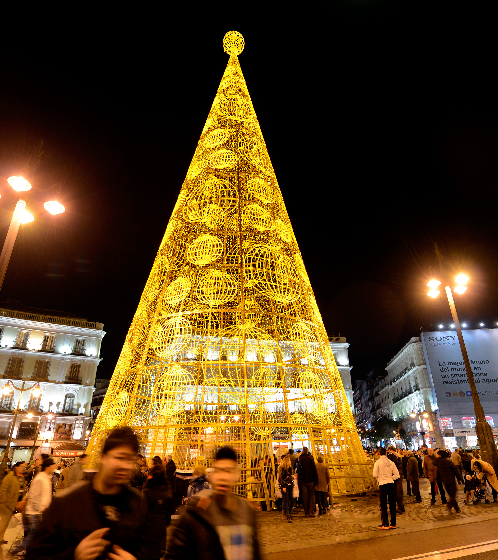 A giant Christmas tree illuminates the Puerta del Sol in the centre of Madrid.