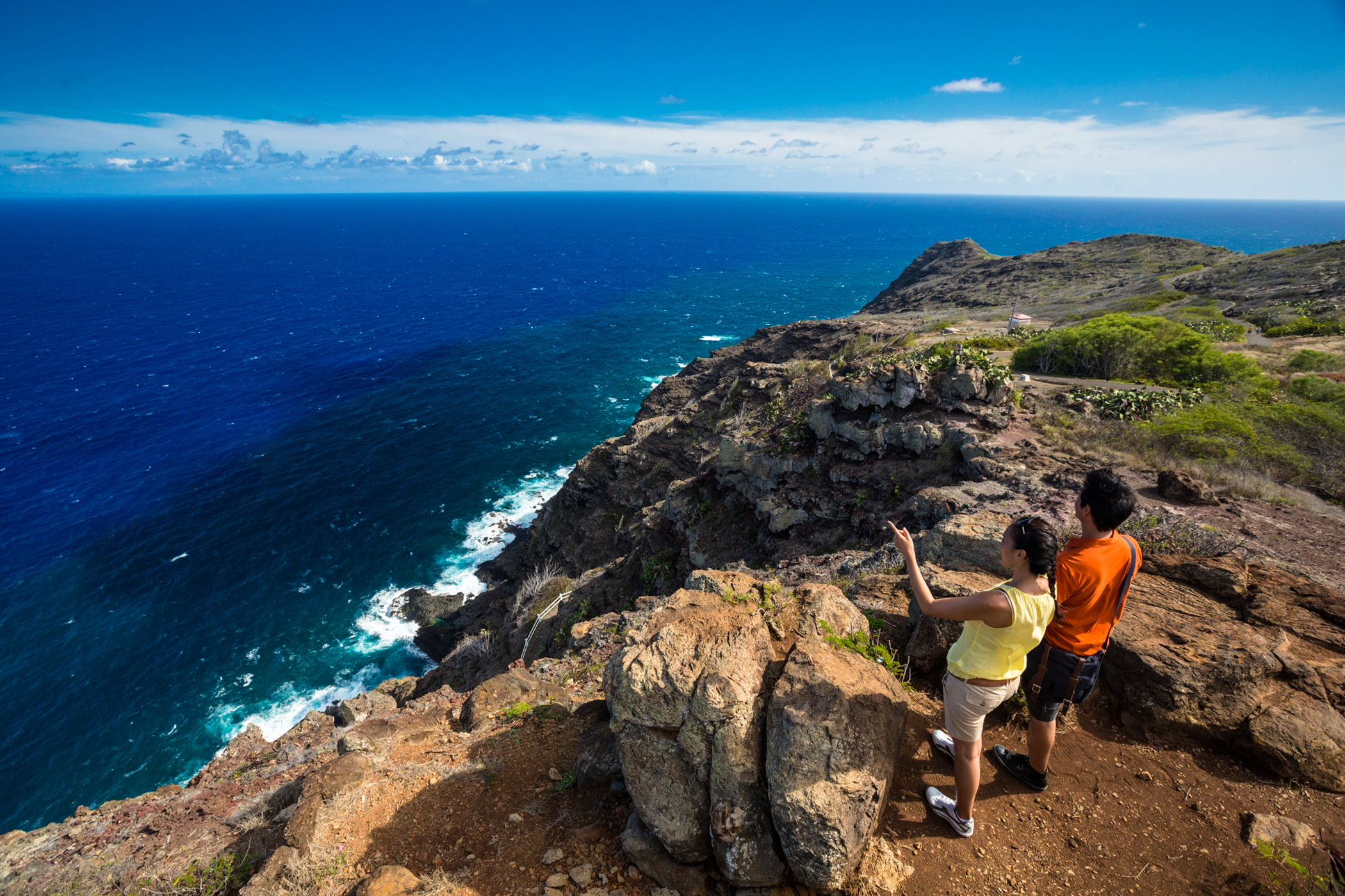 Couple look across the Pacific from Makapuu Trail