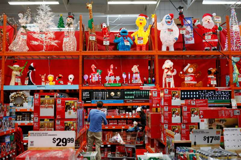 Customers browse Christmas decorations while shopping at a Home Depot Inc. store in Torrance, California, U.S.