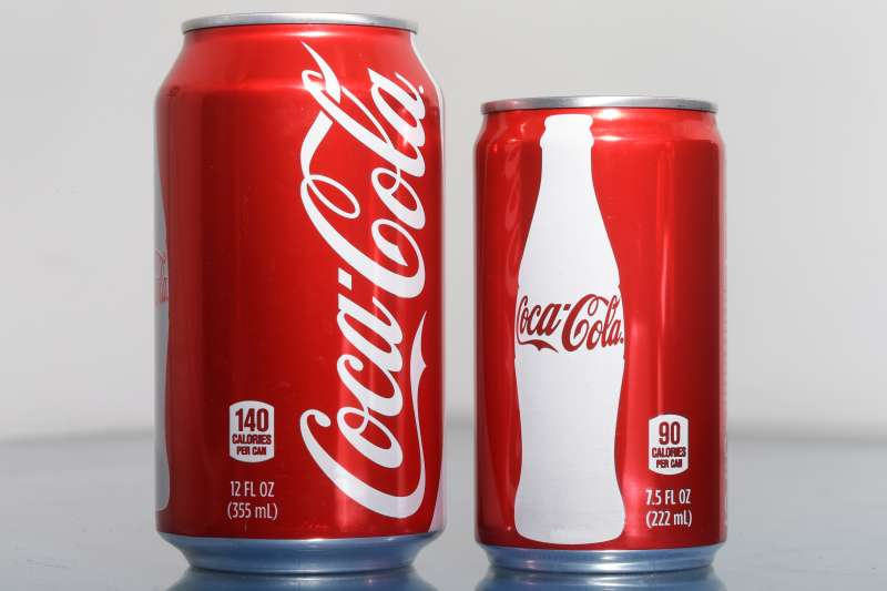 A 7.5-ounce can of Coca-Cola, right, is posed next to its big brother, the traditional 12-ouncer.