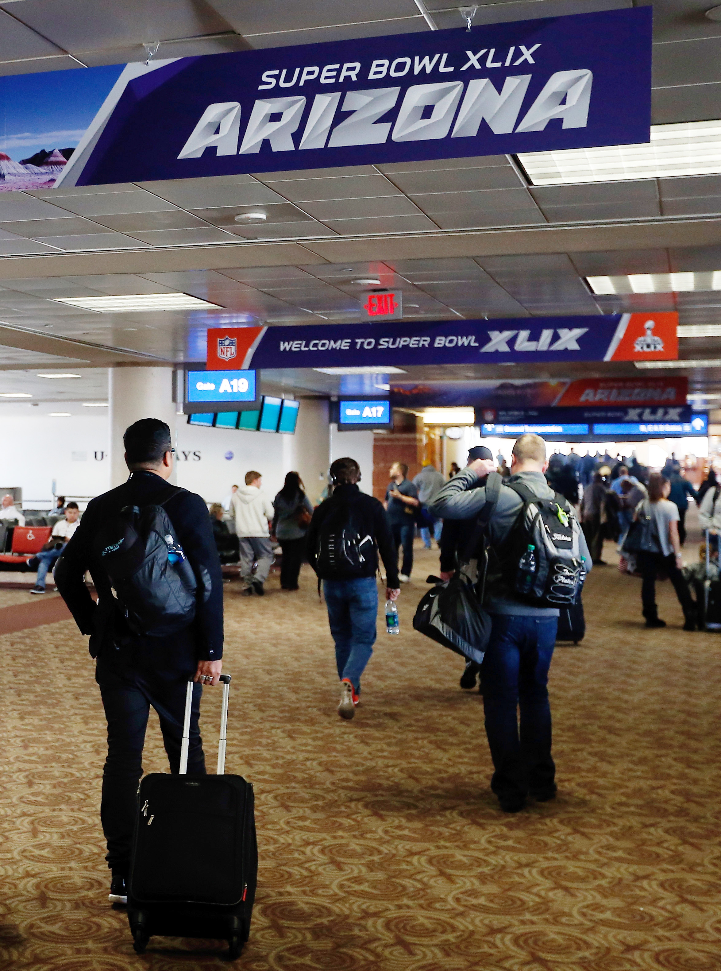 Travelers are already being greeted by Super Bowl XLIX logos at Phoenix Sky Harbor International Airport.