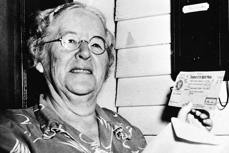 In this Oct. 4, 1950 photo, Ida May Fuller, 76, displays a Social Security check for $41.30 that she received at her home in Ludlow Vt.  On Jan. 31, 1940, Fuller received the country's first Social Security check for $22.54. By the time she died in 1975 at age 100, she had received nearly $23,000 in benefits.