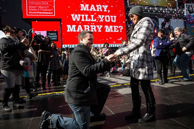 Tom Schwab, 37, proposes to his girlfriend of 18 months, Mary Nubla, 35, in Times Square on February 14, 2014 in New York City.  (She said yes.)