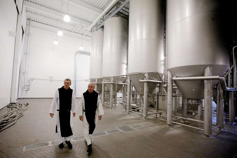 Father Damion, abbot at St. Joseph's Trappist Abbey, left, and Spencer Brewery director Father Isaac, tour the monastery's brewery.