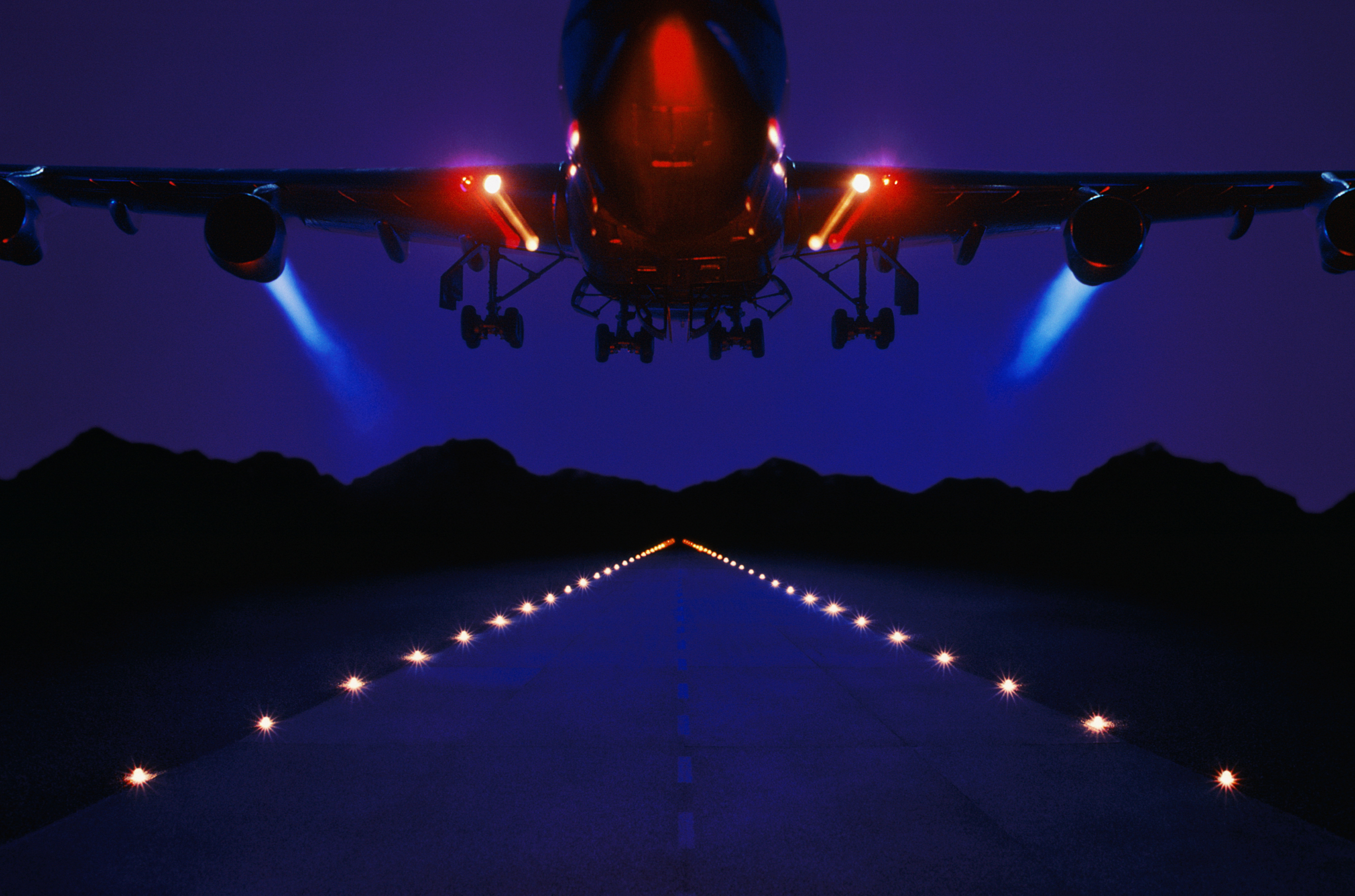 underbelly of jet plane at night