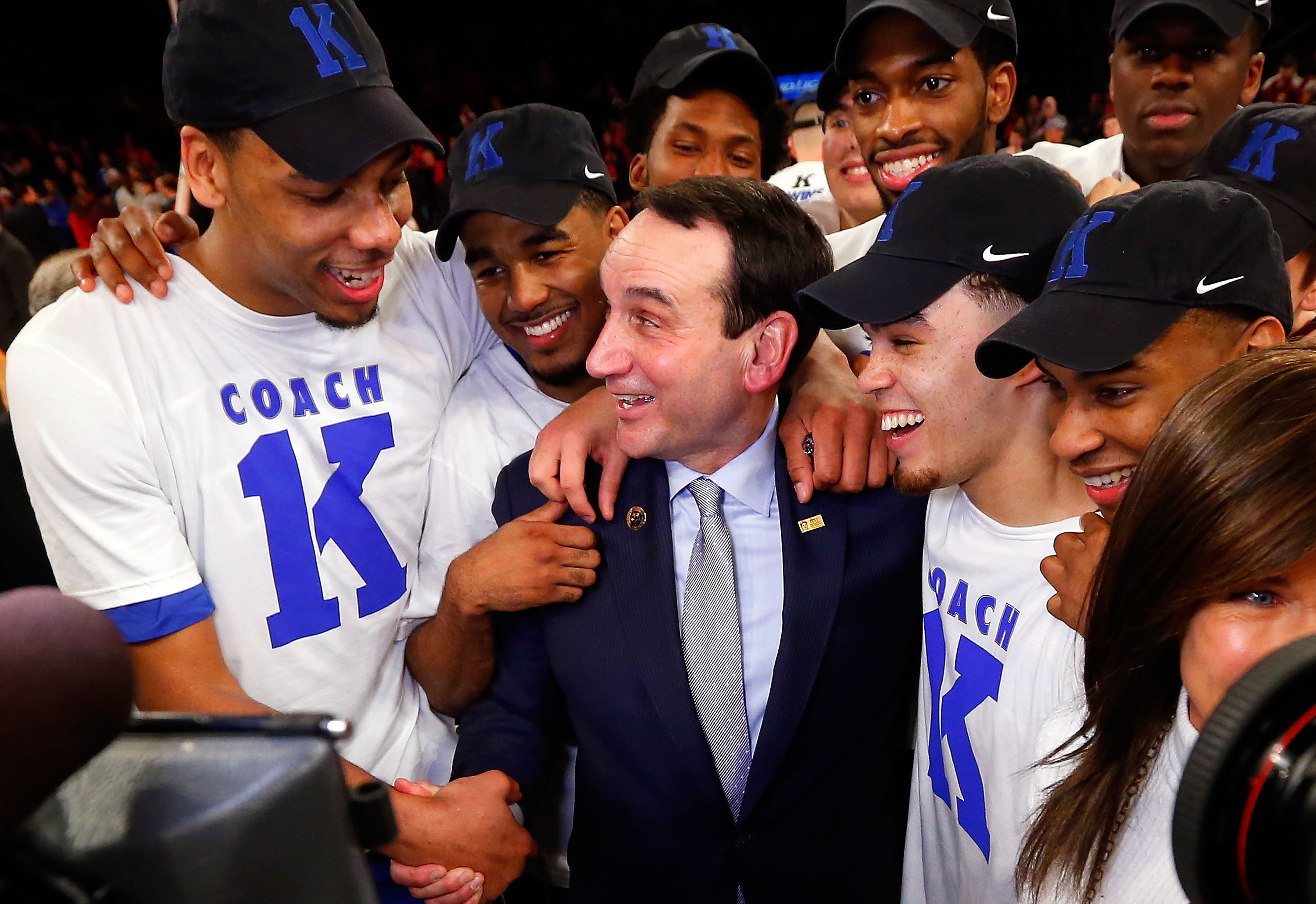 Head coach Mike Krzyzewski of the Duke Blue Devils celebrates with his players after defeating the St. John's Red Storm earning his 1,000th career victory on January 25 2015 at Madison Square Garden in New York City. Duke defeated St John's 77-68.