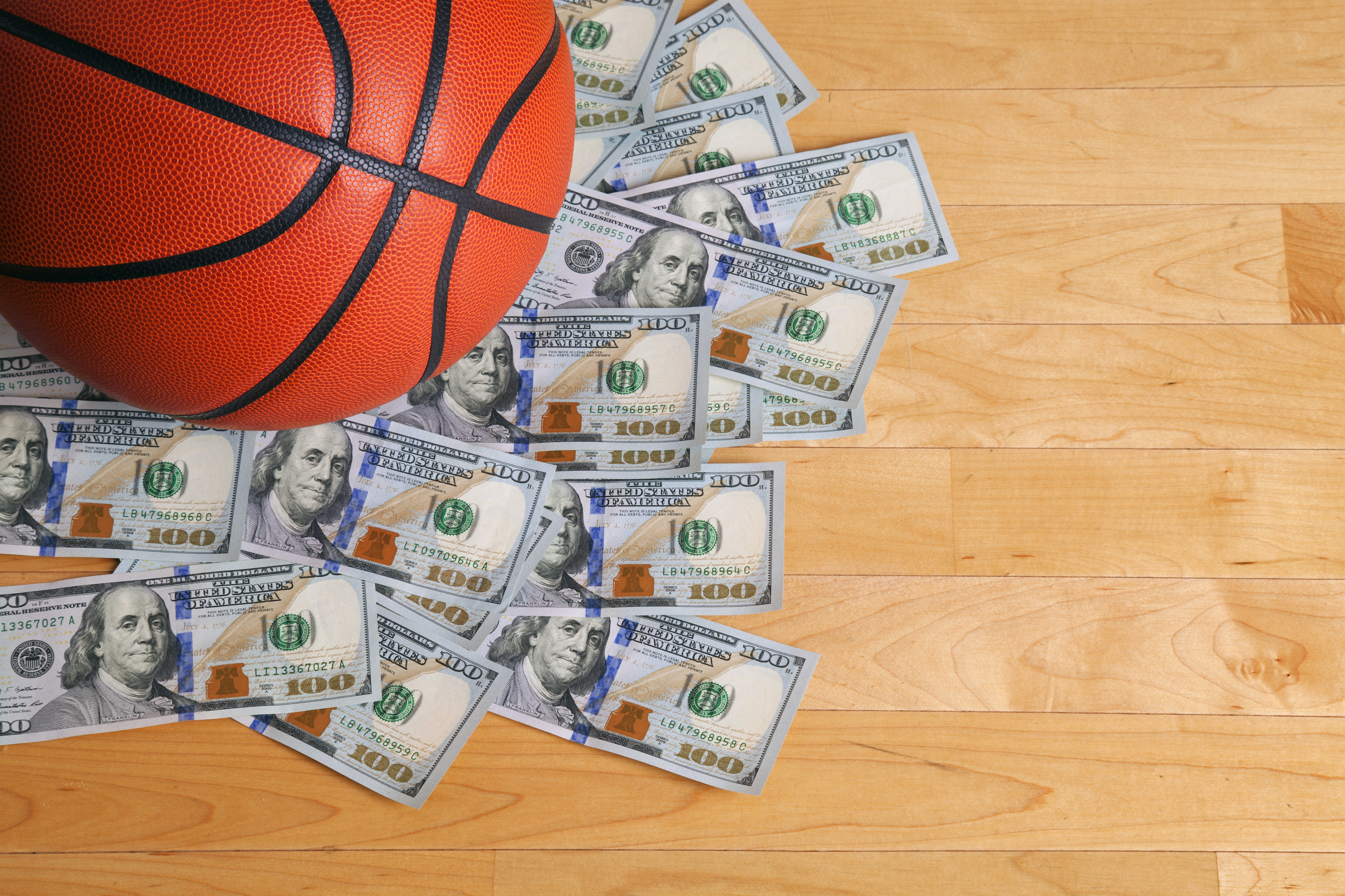 basketball on top of heap of cash