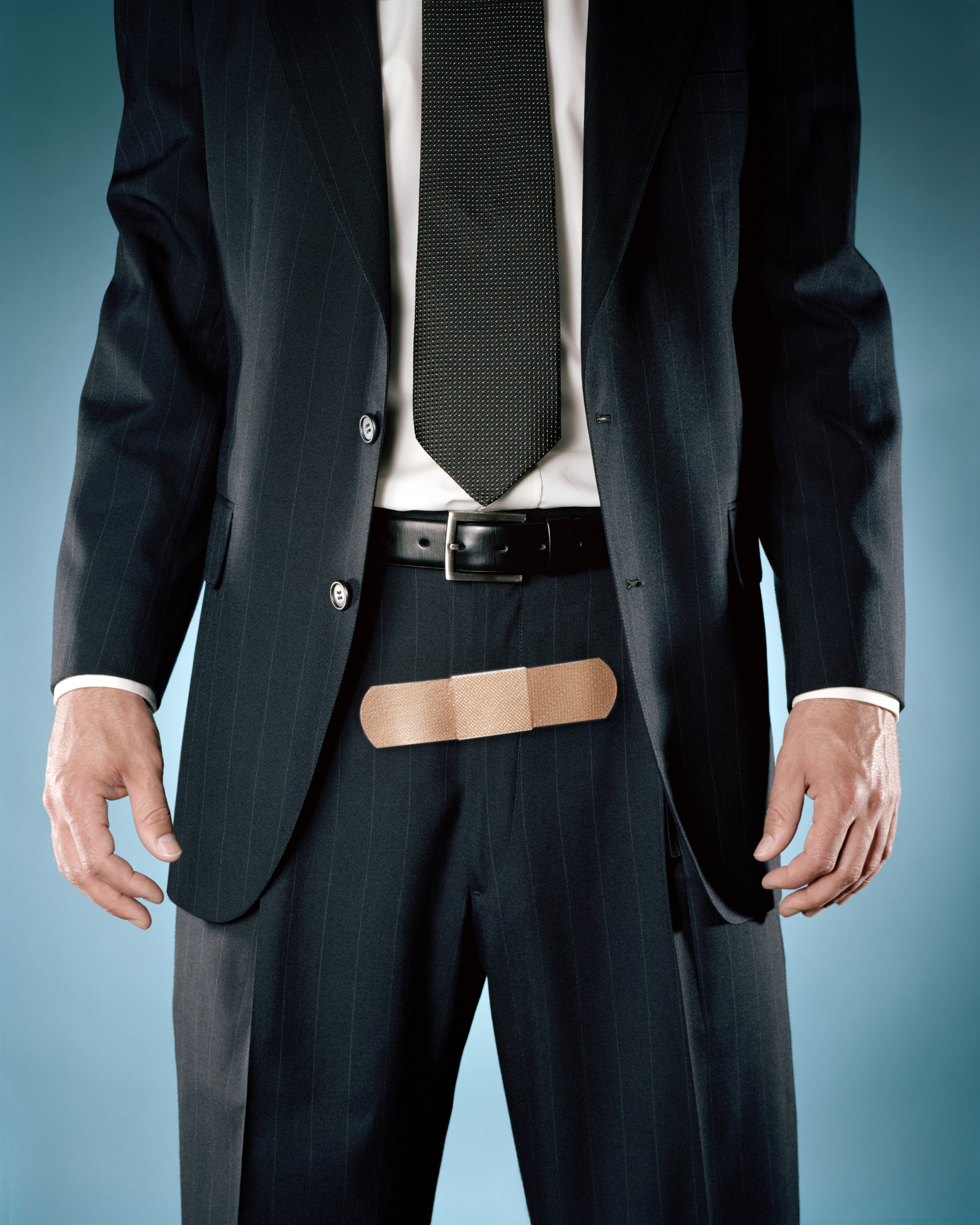 businessman with bandage on zipper