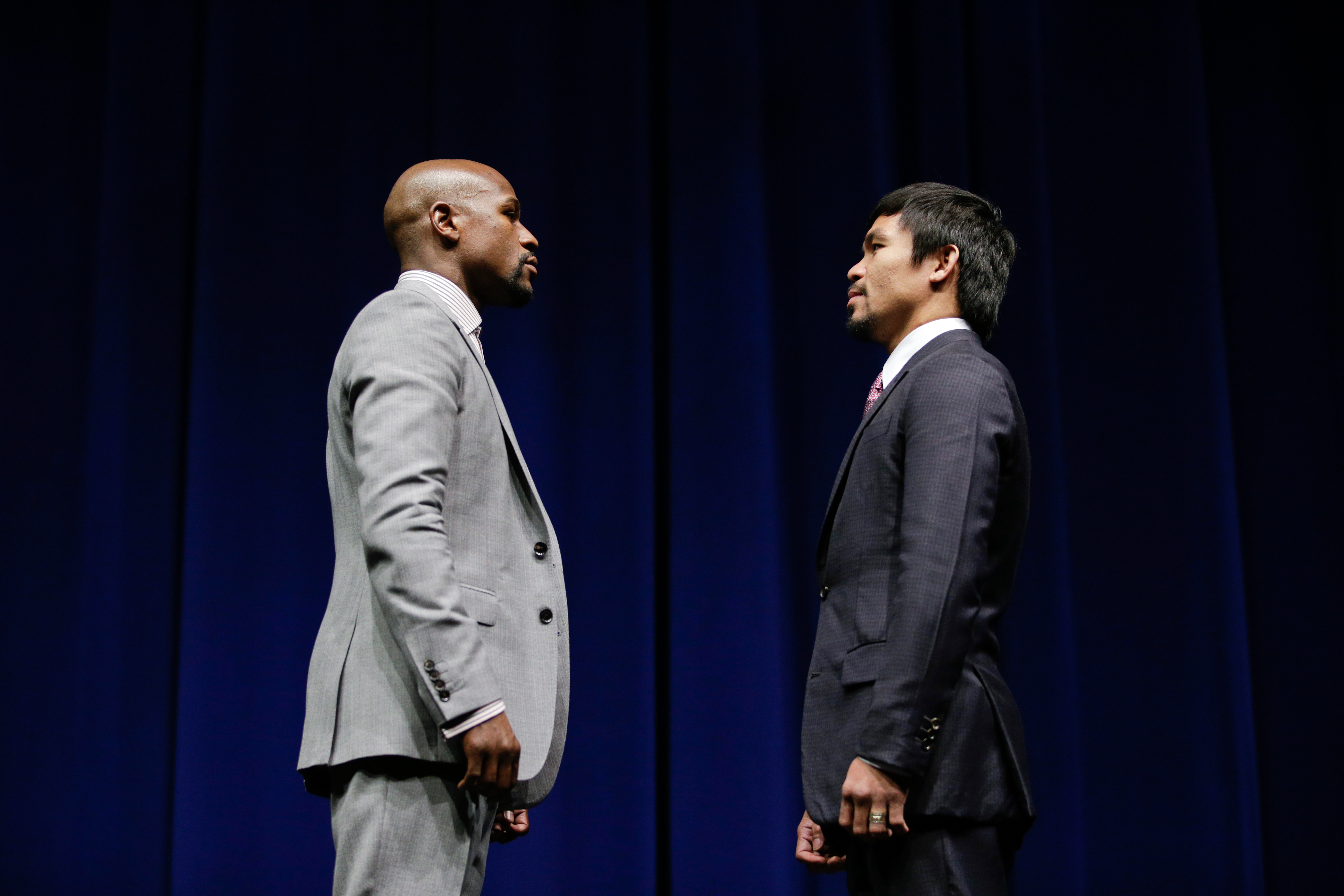 Boxers Floyd Mayweather Jr., left, and Manny Pacquiao, of the Philippines, pose for photos during a news conference, Wednesday, March 11, 2015, in Los Angeles. The two are scheduled to fight in Las Vegas on May 2.