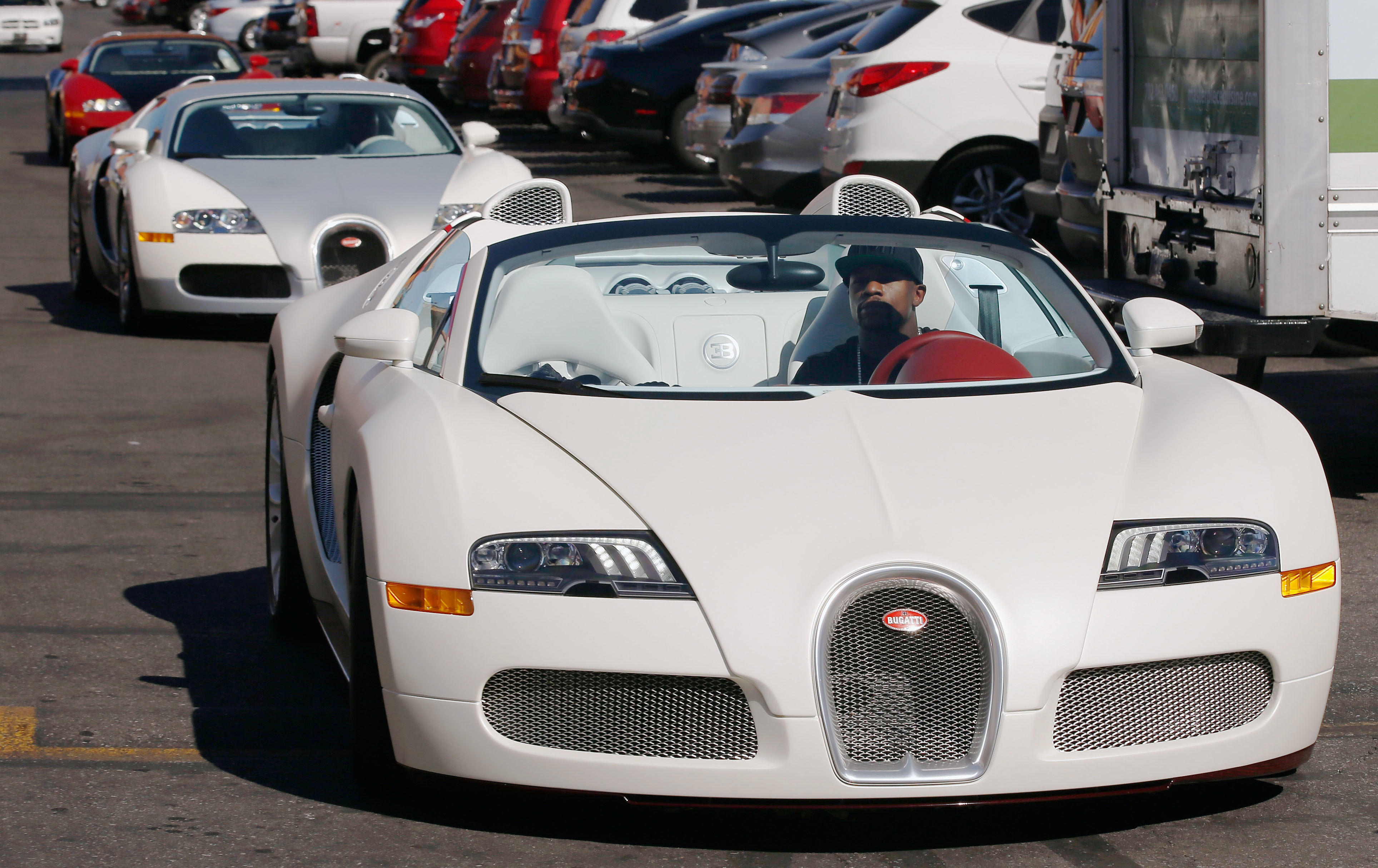 Boxer Floyd Mayweather Jr. (L) arrives in his Bugatti for a work out at the Mayweather Boxing Club on September 2, 2014 in Las Vegas, Nevada.