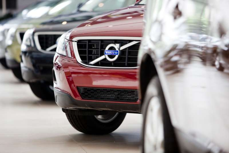 The Volvo automobile logo adorns the grill on one of the company's sedans at a dealership in Beijing, China, on Tuesday, Aug. 3, 2010. Zhejiang Geely Holding Group Co. completed the purchase of Volvo Cars from Ford Motor Co. in the biggest overseas acquisition by a Chinese automaker. Photographer: Nelson Ching/Bloomberg via Getty Images