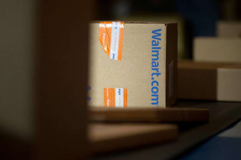 A Wal-Mart Stores Inc. package is unloaded from a trailer to be sorted for final delivery at a FedEx Corp. Ground hub in Hagerstown, Maryland, U.S.