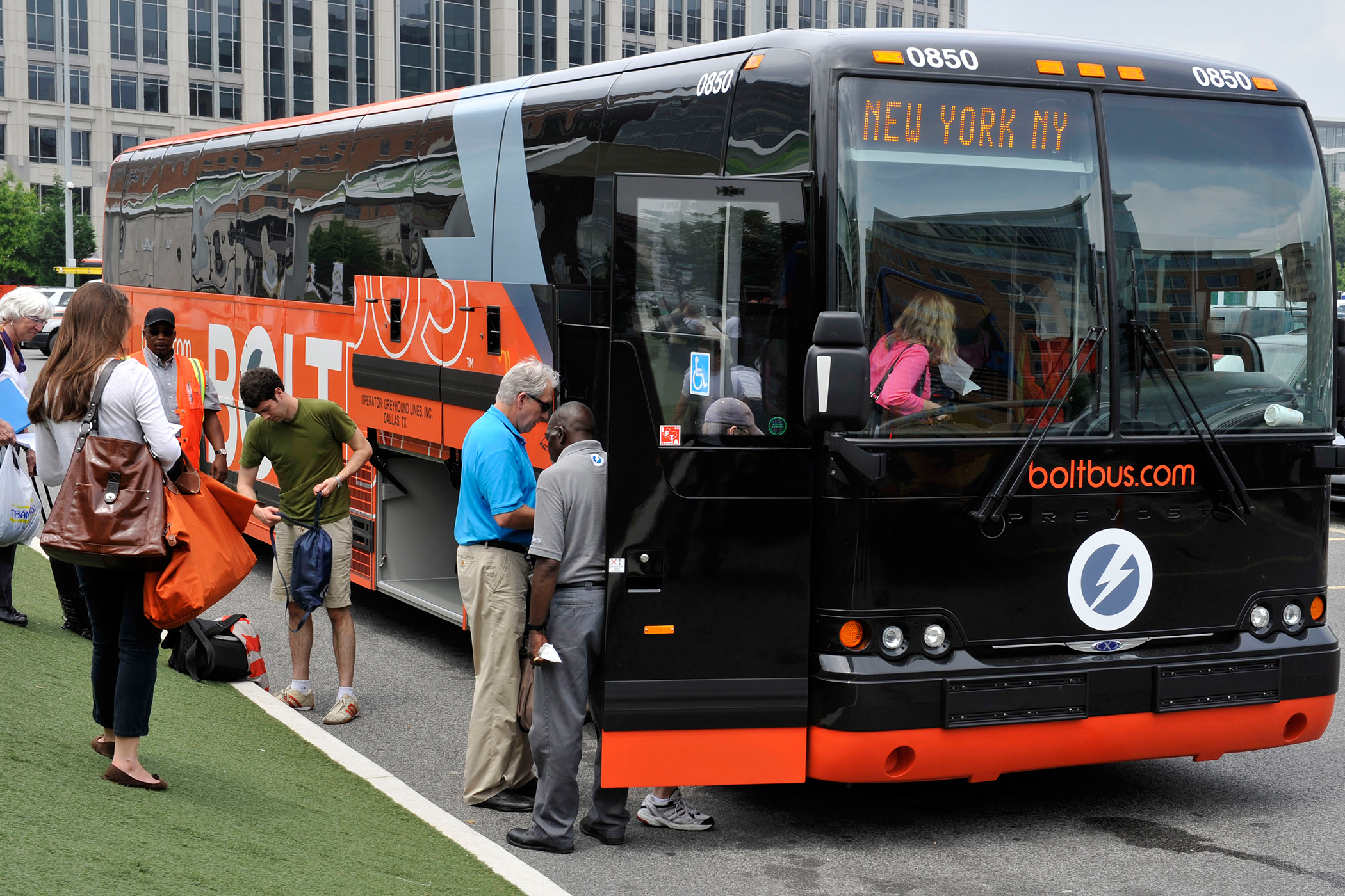 Passengers board a Bolt bus to New York in Washington, D.C.