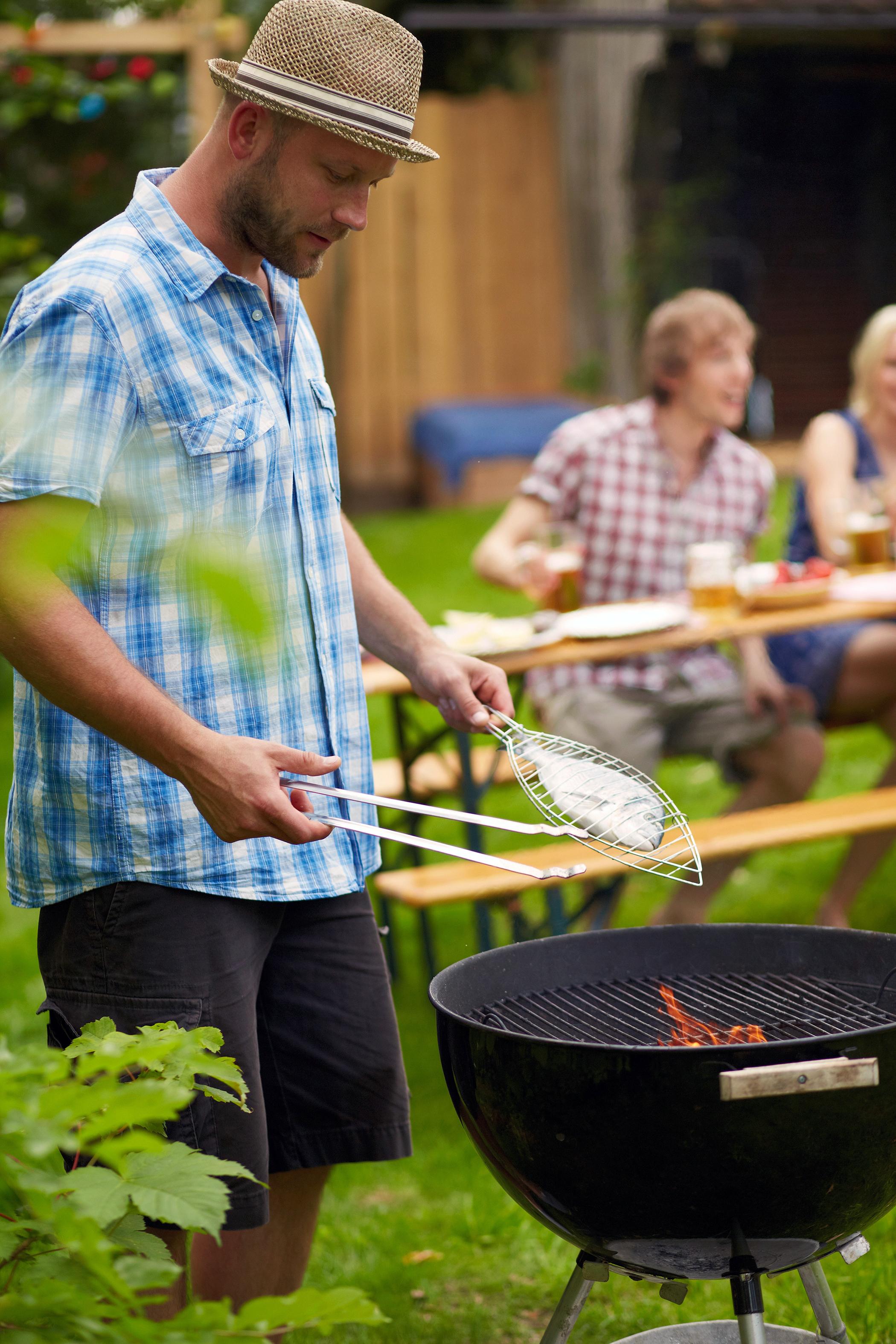 man grilling fish